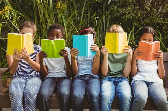 Children reading at park
