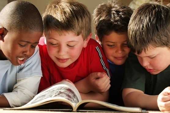 Four boys reading