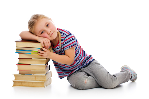 Girl with pile of books