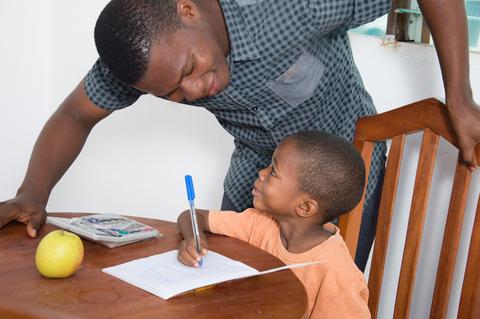 African boy writing